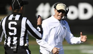 Wake Forest head coach Dave Clawson argues with an official during the first half of their NCAA college football game against Pittsburgh on Saturday, Nov. 17, 2018 in Winston-Salem, N.C. (AP Photo/Woody Marshall)
