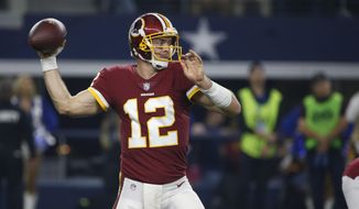 Washington Redskins quarterback Colt McCoy (12) throws against the Dallas Cowboys during the first half of an NFL football game in Arlington, Texas, Thursday, Nov. 22, 2018. (AP Photo/Ron Jenkins)