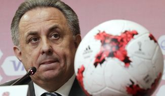 FILE - In this Tuesday, April 25, 2017 file photo, Russia's deputy prime minister in charge of sport, tourism and youth policies Vitaly Mutko attends a news conference after the Russia 2018 LOC Board meeting with FIFA participation in St. Petersburg, Russia. Russian Deputy Prime Minister Vitaly Mutko, who was banned from the Olympics for life over his country's doping scandals, has returned to a senior role in Russian football. (AP Photo/Dmitri Lovetsky, File)