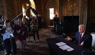 President Donald Trump speaks to reporters following his teleconference with troops from his Mar-a-Lago estate in Palm Beach, Fla., Thursday, Nov. 22, 2018. (AP Photo/Susan Walsh)