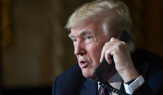 President Donald Trump talks with troops via teleconference from his Mar-a-Lago estate in Palm Beach, Fla., Thursday, Nov. 22, 2018. (AP Photo/Susan Walsh)