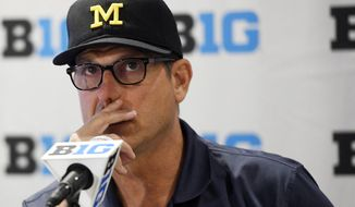 FILE - In this July 23, 2018 file photo Michigan head coach Jim Harbaugh speaks at the Big Ten Conference NCAA college football Media Days in Chicago. Some of college football's most successful coaches, including the great Tom Osborne, have been labeled with the dreaded 'Can't win the big one' tag because of a string of failures against rivals. Coming up short in the game that matters most to your fans can tempt a coach to question everything _ from his Xs and Os to his Jimmys and Joes. Things have not quite reached that level of urgency at Michigan for Jim Harbaugh against Ohio State. But it's getting there. (AP Photo/Annie Rice, file)