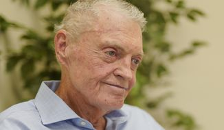 FILE - In this July 31, 2018 file photo, former Nebraska coach Tom Osborne smiles during an interview in his office in Lincoln, Neb. Some of college football's most successful coaches, including Osborne, have been labeled with the dreaded 'Can't win the big one' tag because of a string of failures against rivals. Coming up short in the game that matters most to your fans can tempt a coach to question everything _ from his Xs and Os to his Jimmys and Joes. (AP Photo/Nati Harnik, file)