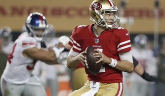 FILE - In this Nov. 12, 2018, file photo, San Francisco 49ers quarterback Nick Mullens looks for a receiver during the second half of the team's NFL football game against the New York Giants in Santa Clara, Calif. Mullens will make the first road start of his NFL career against the Tampa Bay Buccaneers, his first chance to show how he handles a hostile environment after making his first two starts at home. (AP Photo/Tony Avelar, File)