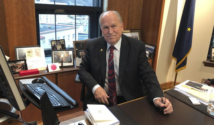 In this Nov. 13, 2018 photo, Alaska Gov. Bill Walker poses in his office at the state Capitol in Juneau, Alaska. Walker, an independent, leaves office Dec. 3, 2018, and will be succeeded by Republican Gov.-elect Mike Dunleavy. (AP Photo/Becky Bohrer)