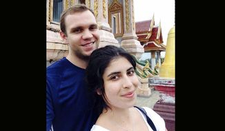 In this undated family photo, showing Matthew Hedges with his wife Daniela Tejada. The 31-year-old British academic Matthew Hedges was arrested May 5, 2018, at Dubai Airport and subsequently convicted and sentenced to life in prison for espionage. The United Arab Emirates Ambassador in London Sulaiman Hamid Almazroui said Friday Nov. 23, 2018, that his government is studying whether to grant clemency to Hedges. (Daniela Tejada via AP, FILE)