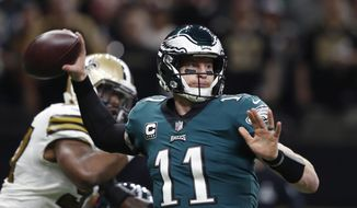 File-This Nov. 18, 2018, file photo shows Philadelphia Eagles quarterback Carson Wentz (11) passing in the first half of an NFL football game against the New Orleans Saints in New Orleans.The defending champion Eagles (4-6) have lost two in a row and some misguided fans were even calling for Super Bowl MVP Nick Foles to replace Wentz in the starting lineup following his career-worst effort in a 48-7 loss to New Orleans. (AP Photo/Gerald Herbert, File)