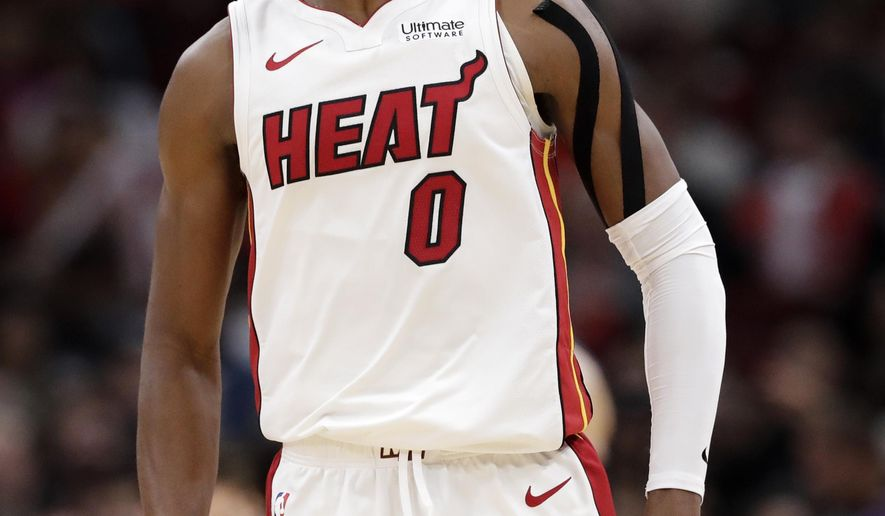 Miami Heat guard Josh Richardson reacts after he made a three-point basket during the second half of an NBA basketball game against the Chicago Bulls, Friday, Nov. 23, 2018, in Chicago. The Heat won 103-96. (AP Photo/Nam Y. Huh)
