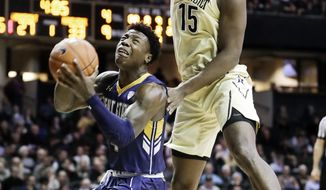 Kent State guard Antonio Williams, left, shoots as he is defended by Vanderbilt forward Clevon Brown (15) in the first half of an NCAA college basketball game Friday, Nov. 23, 2018, in Nashville, Tenn. (AP Photo/Mark Humphrey)