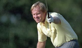 FILE - In this April 13, 1986 file photo, golfer Jack Nicklaus watches his shot go for a birdie on the 17th at the Masters Tournament in Augusta, Ga. He wore a yellow shirt that day to honor a young fan who died at a young age from cancer. (AP Photo/Joe Benton, File)