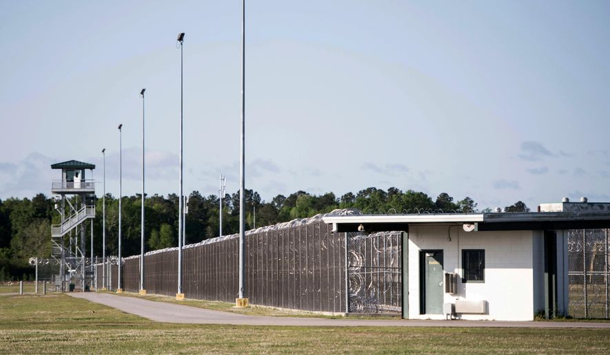 FILE - This April 16, 2018 file photo shows the Lee Correctional Institution in Bishopville, S.C. A review by The Associated Press has found prisoners who kill other prisoners behind bars in South Carolina often face little additional punishment. Prosecutors won convictions in 18 of 26 closed cases involving the deaths of inmates at the hands of fellow prisoners in the past 20 years. State agents are still investigating the deaths of seven inmates during an April riot at Lee Correctional Institution. No charges have been filed yet. (AP Photo/Sean Rayford, File)