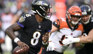 FILE- In this Nov. 18, 2018, file photo Baltimore Ravens quarterback Lamar Jackson (8) looks for a receiver in the first half of an NFL football game against the Cincinnati Bengals in Baltimore. Understanding that 27 carries a game is way too dangerous for an NFL quarterback, Jackson may do things differently in his second NFL start Sunday, Nov. 25. (AP Photo/Nick Wass, File)