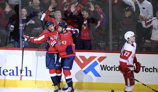 Washington Capitals left wing Alex Ovechkin, left, of Russia, celebrates his goal with right wing Tom Wilson (43) as Detroit Red Wings center Michael Rasmussen (27) skates by during the third period of an NHL hockey game Friday, Nov. 23, 2018, in Washington. The Capitals won 3-1. (AP Photo/Nick Wass) ** FILE **