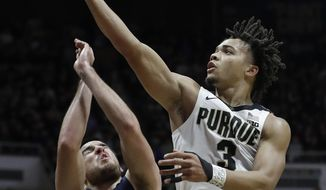 Purdue's Carsen Edwards, right, shoots over Robert Morris's Matty McConnell, left, during the second half of an NCAA college basketball game, Friday, Nov. 23, 2018, in West Lafayette, Ind. Purdue won 84-46. (AP Photo/Darron Cummings)