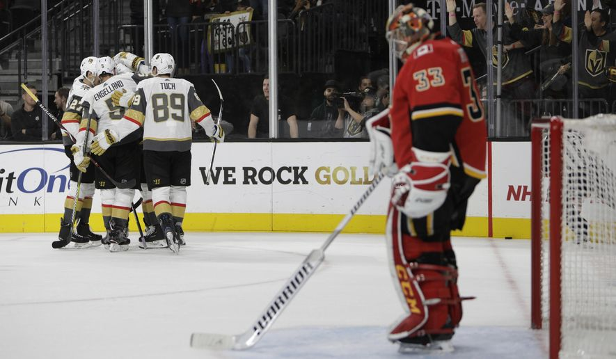 The Vegas Golden Knights celebrate after right wing Alex Tuch (89) scored a goal against the Calgary Flames during the second period of an NHL hockey game Friday, Nov. 23, 2018 in Las Vegas. (AP Photo/Joe Buglewicz)