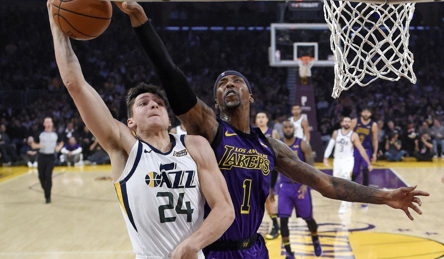 Utah Jazz guard Grayson Allen, left, has his shot blocked by Los Angeles Lakers guard Kentavious Caldwell-Pope during the first half of an NBA basketball game Friday, Nov. 23, 2018, in Los Angeles. (AP Photo/Mark J. Terrill)