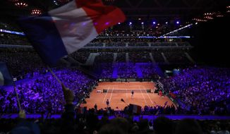 France's Nicolas Mahut and Pierre Hughes Herbert, bottom, in their Davis Cup final against Croatia's Ivan Dodig and Mate Pavic, Saturday, Nov. 24, 2018 in Lille, northern France. Croatia is within one point of a second Davis Cup title after Borna Coric and Marin Cilic dispatched their French rivals in the opening singles matches of the final to take a 2-0 lead. (AP Photo/Thibault Camus)