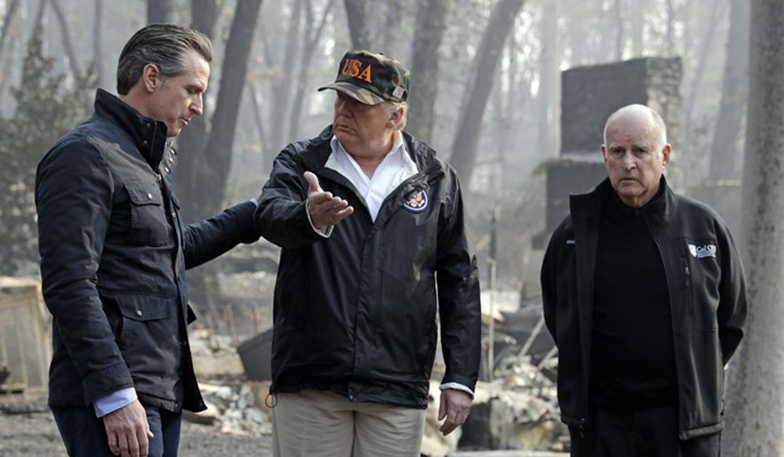 In this Nov. 17, 2018 file photo, President Donald Trump talks with Gov.-elect Gavin Newsom, left, as California Gov. Jerry Brown listens during a visit to a neighborhood impacted by the Camp wildfire in Paradise, Calif. For US governors, including 19 taking office early next year, fires, floods and other climate-related emergencies could become top policy concerns. For some, the concern is often trying to curtail global warming. But other leaders also have taken steps to mitigate damage from future disasters. (AP Photo/Evan Vucci) **FILE**