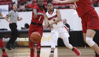 Hartford's Jordan McLemore, right, passes the ball next to Louisville's Dana Evans during the first half of an NCAA college basketball game Saturday, Nov. 24, 2018, in Las Vegas. (AP Photo/Chase Stevens)