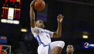 Buffalo guard Davonta Jordan (4) drives to the basket during the first half of an NCAA college basketball game against Marist, Saturday, Nov. 24, 2018, in Buffalo N.Y. (AP Photo/Jeffrey T. Barnes)