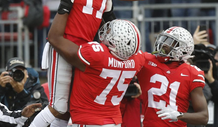 Ohio State receiver Chris Olave (17) celebrates his touchdown against Michigan during the first half of an NCAA college football game Saturday, Nov. 24, 2018, in Columbus, Ohio. (AP Photo/Jay LaPrete)