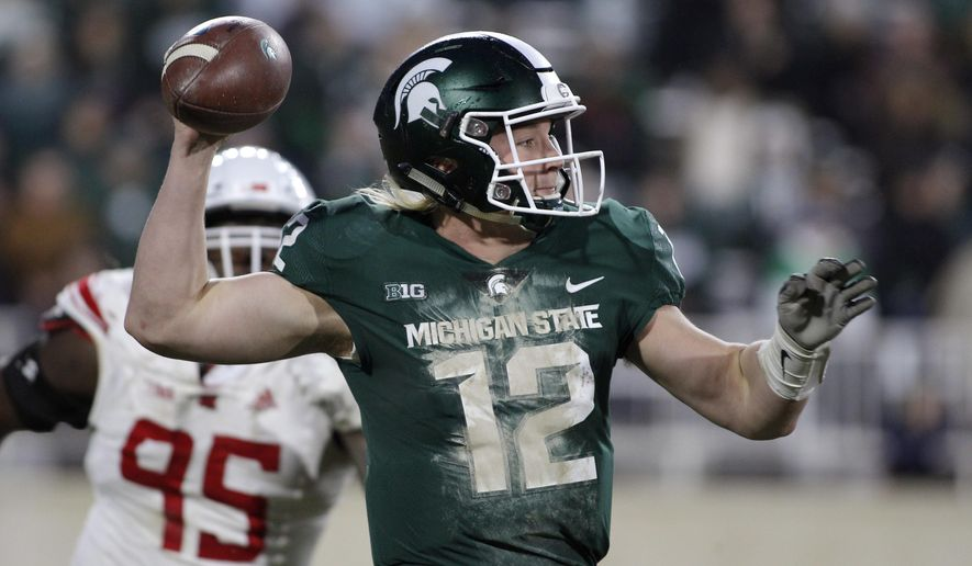 Michigan State quarterback Rocky Lombardi (12) prepares to pass as Rutgers' Jon Bateky (95) pursues during the second quarter of an NCAA college football game, Saturday, Nov. 24, 2018, in East Lansing, Mich. (AP Photo/Al Goldis)