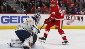 Buffalo Sabres goaltender Linus Ullmark (35) stops a shot-on-goal by Detroit Red Wings right wing Anthony Mantha (39) during the second period of an NHL hockey game, Saturday, Nov. 24, 2018, in Detroit. (AP Photo/Carlos Osorio)