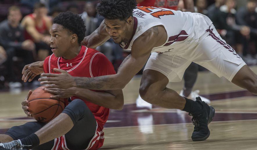 Virginia Tech guard Ahmed Hill (13) goes for a loose ball against Saint Francis guard Ramiir Dixon-Conover (1) during the first half of an NCAA college basketball game Saturday, Nov. 24, 2018, in Blacksburg, Va. (AP Photo/Don Petersen)