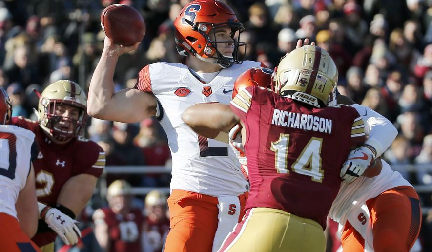 Syracuse quarterback Eric Dungey (2) looks to pass under pressure from Boston College linebacker Max Richardson (14) during the first half of an NCAA college football game, Saturday, Nov. 24, 2018, in Boston. (AP Photo/Mary Schwalm)