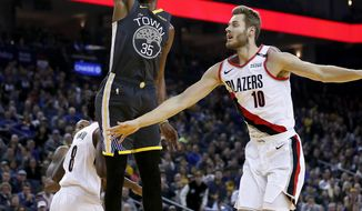 Golden State Warriors forward Kevin Durant (35) dunks in front of Portland Trail Blazers forward Jake Layman (10) during the first half of an NBA basketball game in Oakland, Calif., Friday, Nov. 23, 2018. (AP Photo/Tony Avelar)
