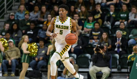George Mason senior guard Jaire Grayer spent the summer passing out bottled water to citizens who were in need of clean drinking water in his native Flint, Michigan. (Rafael Suanes/George Mason Athletics)