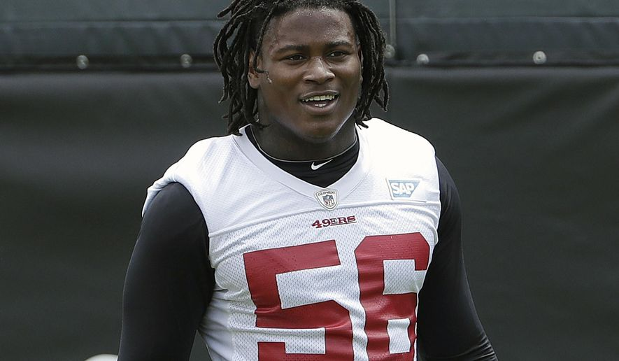 FILE - In this May 30, 2018, file photo, San Francisco 49ers linebacker Reuben Foster walks on the field during a practice at the team's NFL football training facility in Santa Clara, Calif. Foster was arrested Saturday, Nov. 24, at the team hotel on charges of domestic violence. (AP Photo/Jeff Chiu, File)