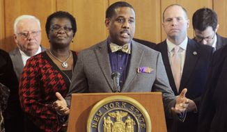 Sen. Kevin Parker, D- Brooklyn, stands with Senate members announcing that they are working on legislation to make voting easier for New Yorkers, during a news conference at the Capitol, Monday, Feb. 6, 2017, in Albany, N.Y. (AP Photo/Hans Pennink)