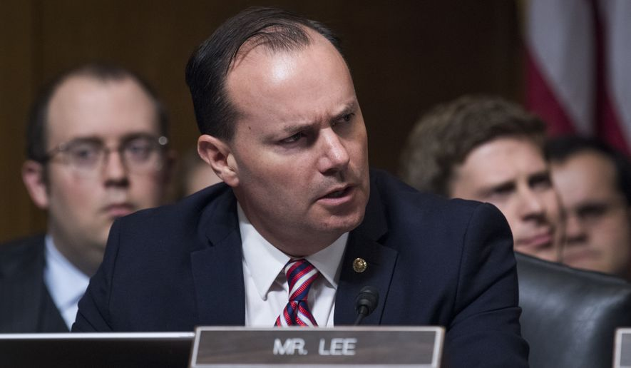 Sen. Mike Lee, R-Utah, listens to testimony by Dr. Christine Blasey Ford during the Senate Judiciary Committee hearing on the nomination of Brett M. Kavanaugh to be an associate justice of the Supreme Court of the United States, focusing on allegations of sexual assault by Kavanaugh against Christine Blasey Ford in the early 1980s. Sen. Orrin Hatch, R-Utah, also appears. (Photo By Tom Williams/CQ Roll Call/POOL) ** FILE **