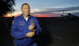 Director General of the Russia state corporation Roscosmos Dmitry Rogozin walks in Baikonur airport after a rescue operation for NASA astronaut Nick Hague and Russian cosmonaut Alexey Ovchinin after an emergency landing, in Kazakhstan, Thursday, Oct. 11, 2018. Two astronauts from the U.S. and Russia were safe Thursday after an emergency landing in the steppes of Kazakhstan following the failure of a Russian booster rocket carrying them to the International Space Station. (Yuri Kochetkov/Pool Photo via AP)