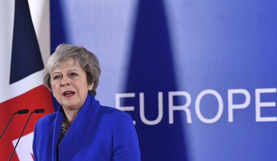 British Prime Minister Theresa May speaks during a media conference at the conclusion of an EU summit in Brussels, Sunday, Nov. 25, 2018. European Union gathered Sunday to seal an agreement on Britain's departure from the bloc next year, the first time a member country will have left the 28-nation bloc. (AP Photo/Geert Vanden Wijngaert)