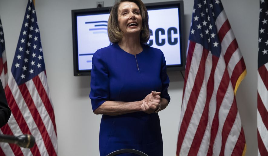 House Democratic Leader Nancy Pelosi of California, smiles as she meets with reporters on Election Day at the Democratic National Committee headquarters in Washington. (AP Photo/J. Scott Applewhite, File)