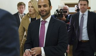 In this Oct. 25, 2018, photo, George Papadopoulos, the former Trump campaign adviser who triggered the Russia investigation, arrives for his first appearance before congressional investigators, on Capitol Hill in Washington. A judge has rejected an effort by former Trump campaign foreign policy adviser Papadopoulos to delay his two-week prison term and says Papadopoulos must surrender Monday, Nov. 26, as scheduled. (AP Photo/Carolyn Kaster) **FILE**