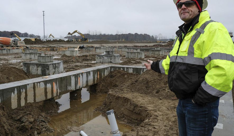 In this Friday, Nov. 9, 2018 photo, Project Manager John Murphy talks about the special fill dirt used for the new cheese and dairy processing plant being built in Bingham Township in St. Johns, Mich. (Robert Killips/Lansing State Journal via AP)