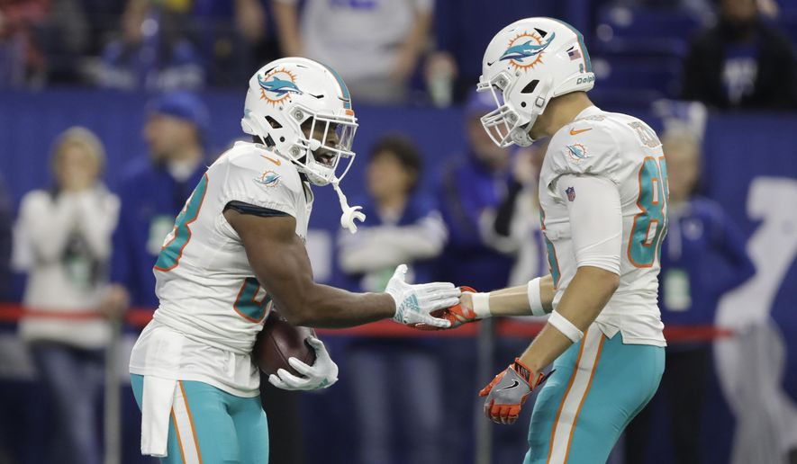 faf796086 Miami Dolphins wide receiver Leonte Carroo (88) celebrates his touchdown  with tight end Mike