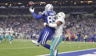 Indianapolis Colts tight end Eric Ebron (85) makes a touchdown catch over Miami Dolphins strong safety T.J. McDonald, right, during the first half of an NFL football game in Indianapolis, Sunday, Nov. 25, 2018. (AP Photo/Michael Conroy)