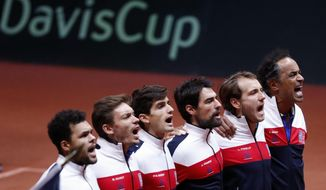 The French team, from the left, France's Jo-Wilfried Tsonga, Pierre Hughes Herbert, Nicolas Mahut, Jeremy Chardy , Lucas Pouille and team captain Yannick Noah sing the national anthem before the Davis Cup final between France and Croatia Sunday, Nov. 25, 2018 in Lille, northern France. (AP Photo/Thibault Camus)