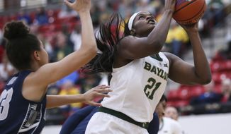 Baylor's Kalani Brown (21) shoots against Georgetown during the first half of an NCAA college basketball game Saturday, Nov. 24, 2018, in Las Vegas. (AP Photo/Chase Stevens)