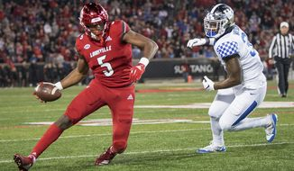 Louisville wide receiver Seth Dawkins (5) scrambles with the ball during the first half of the team's NCAA college football game against Kentucky in Louisville, Ky., Saturday, Nov. 24, 2018. (AP Photo/Bryan Woolston)