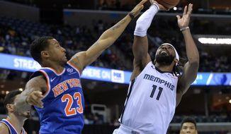 Memphis Grizzlies guard Mike Conley (11) shoots against New York Knicks guard Trey Burke (23) in the second half of an NBA basketball game Sunday, Nov. 25, 2018, in Memphis, Tenn. (AP Photo/Brandon Dill)