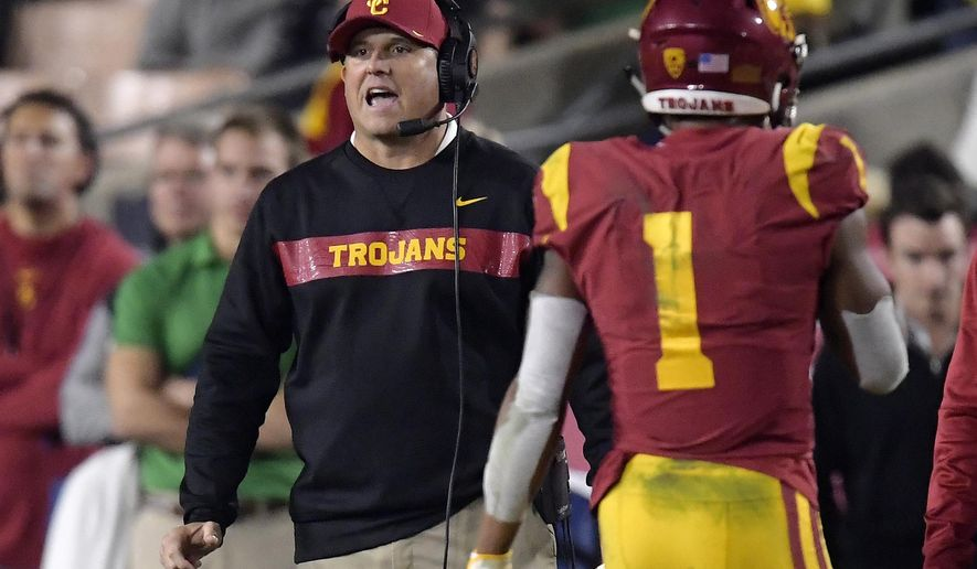 Southern California coach Clay Helton, left, yells to his team as Southern California wide receiver Velus Jones Jr. walks off the field during the second half of an NCAA college football game against Notre Dame on Saturday, Nov. 24, 2018, in Los Angeles. Notre Dame won 24-17. (AP Photo/Mark J. Terrill)