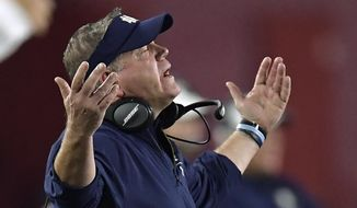 Notre Dame coach Brian Kelly gestures to officials during the second half of the team's NCAA college football game against Southern California on Saturday, Nov. 24, 2018, in Los Angeles. Notre Dame won 24-17. (AP Photo/Mark J. Terrill)