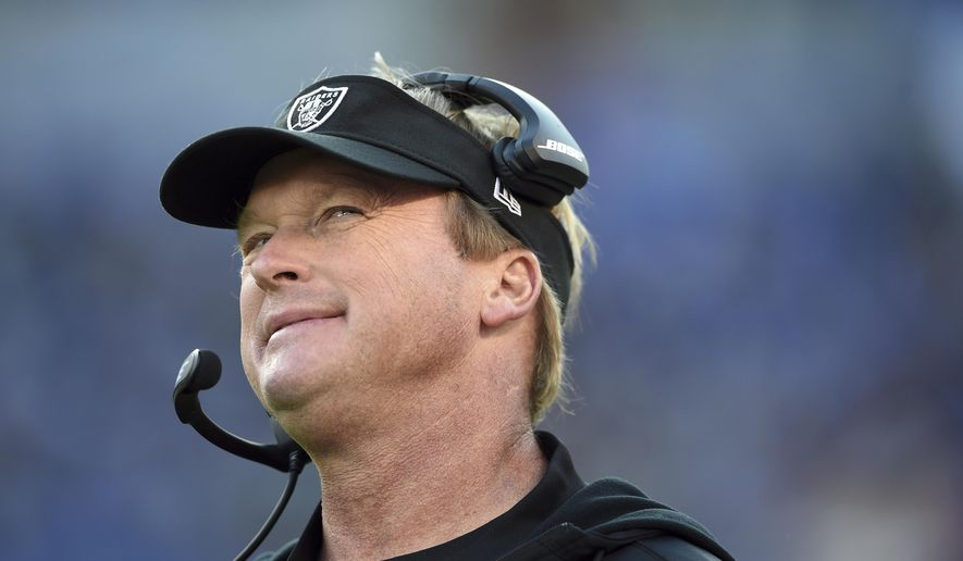 Oakland Raiders head coach Jon Gruden stands on the sideline in the second half of an NFL football game against the Baltimore Ravens, Sunday, Nov. 25, 2018, in Baltimore. (AP Photo/Gail Burton) ** FILE **