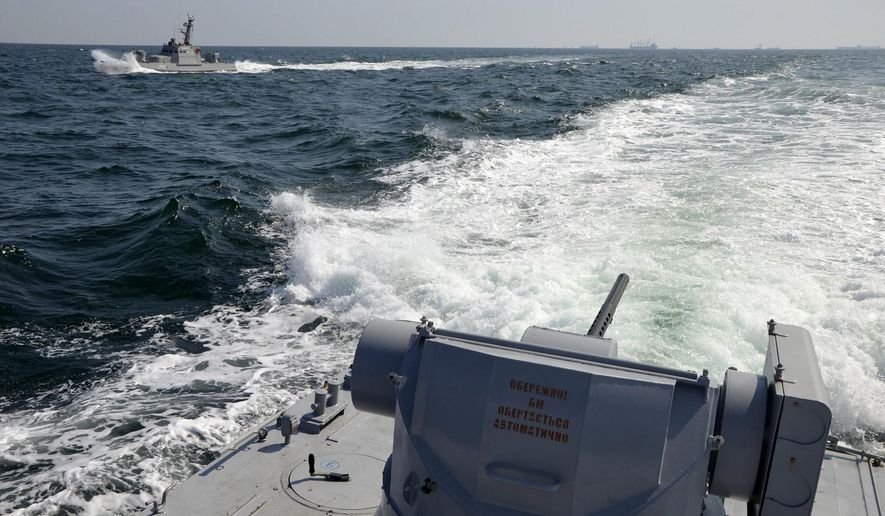 In this file photo taken and distributed by Ukrainian Navy Press Service on Sunday, Nov. 25, 2018, two Ukrainian forces navy ships are seen near Crimea. The Ukrainian navy says a Russian coast guard vessel rammed a Ukrainian navy tugboat near Crimea, damaging the ship's engines and hull. (Ukrainian Navy Press Service via AP)