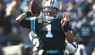 Carolina Panthers' Cam Newton (1) looks to pass against the Seattle Seahawks during the first half of an NFL football game in Charlotte, N.C., Sunday, Nov. 25, 2018. (AP Photo/Jason E. Miczek)